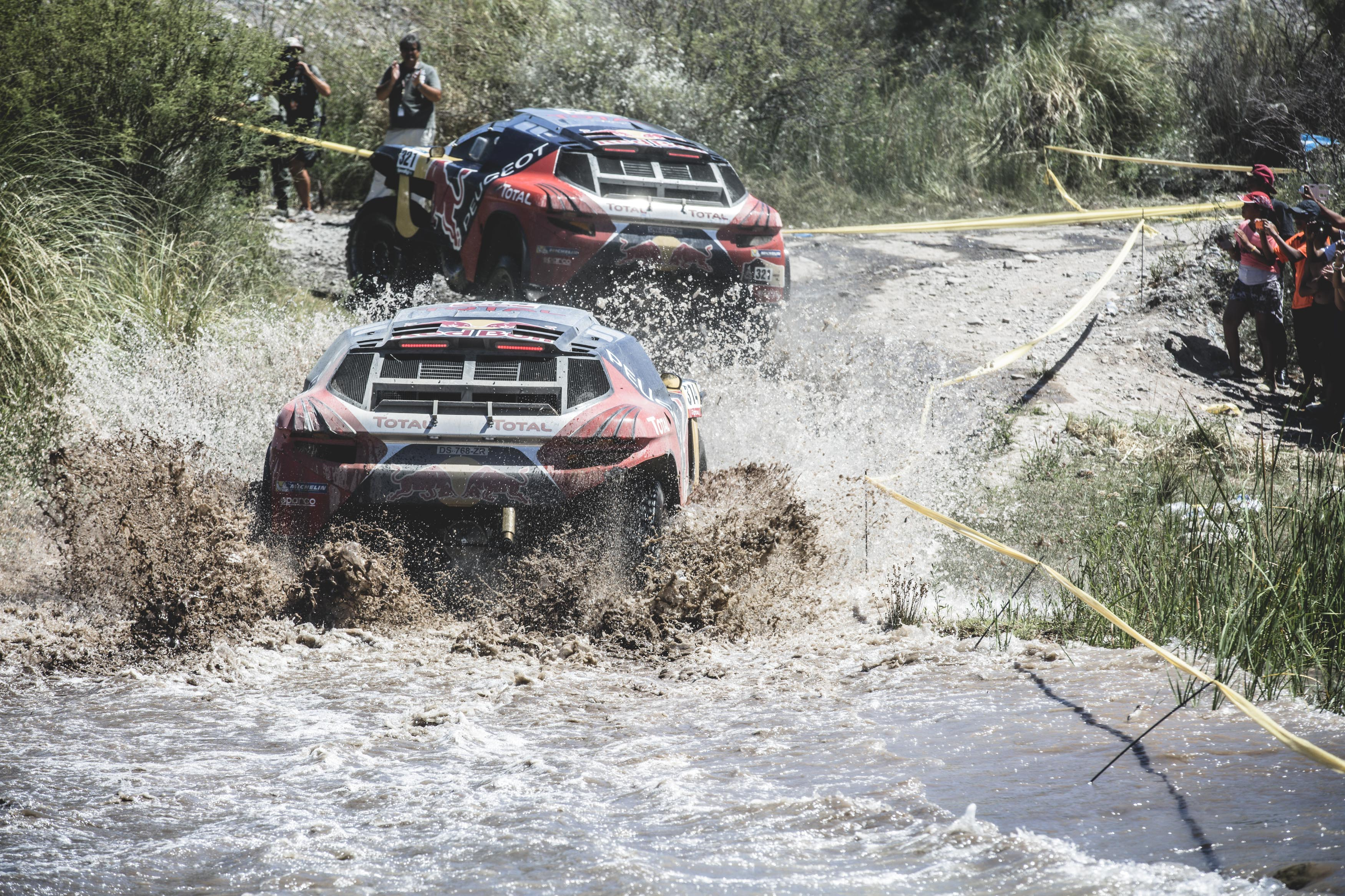 Sebastien Loeb (FRA) from Team Peugeot Total is towed by Cyril Despres (FRA) during stage 11 of Rally Dakar 2016 from La Rioja to San Juan, Argentina on January 14, 2016.